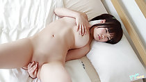 Naked on bed legs spread hand over her shaved pussy lips hand covering her breasts