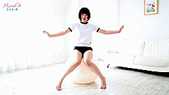 Balancing On Ball In Gym Class Uniform Arms Raised Short Hair