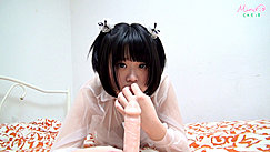Minori Lying On Bed Short Hair Hand Raised To Her Mouth