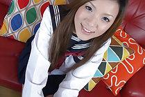 Kogal Yua Ando raises uniform skirt to flash shaved pussy