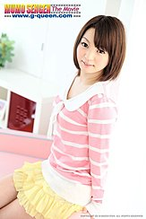 Sitting On Couch Short Hair Reaching Down To Her Shoulders In Pink Striped Top And Yellow Skirt