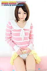 Raising Hem Of Her Skirt Exposing Her White Panties Short Hair Curls Around Her Face In Pink Top