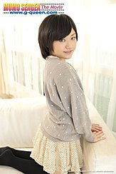 Mei Kadowaki Kneeling On Couch Looking Past Her Shoulder Short Hair Frames Her Pretty Smile Wearing Short Skirt
