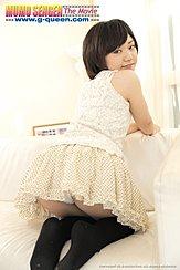 Mei Kadowaki Kneeling On Couch Looking Over Her Shoulder Wearing Short Skirt
