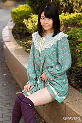 Mai Araki Seated On Wall Lifting Hem Of Her Dress Over Her Thigh