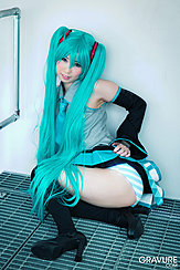 Squatting In Cosplay Outfit Raising Hem Of Skirt Over Her Ass