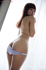 Standing In Window Light Looking Down Over Her Bare Shoulder Long Hair Down Her Back Panties Pulled Down Over Her Round Bare Ass