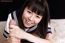 Student Araki Mai in uniform giving big cock handjob