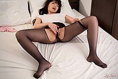Lying On Bed With Her Legs Spread Masturbating Her Pussy Through Her Ripped Pantyhose