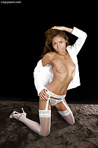 Kneeling down hand on her head shirt open puffy nipples on her small breasts hand on hip in white stockings high heels