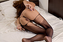 Sugisaki Nanami masturbates on bed in ripped pantyhose