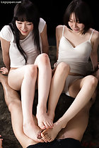 Kawagoe Yui and friend in sleepwear giving footjob with bare feet to bottomless man