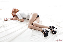 Kobayashi Chie lying on her side showing panties in high heels