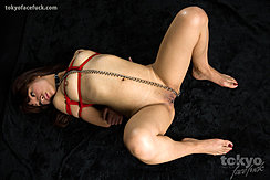 On Her Back Naked Looking To The Side Arms Bound With Rope Over Her Small Breasts Legs Spread Bondage Chain Over Her Shaved Pussy Bare Feet