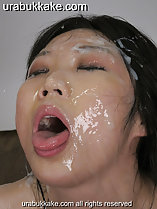 Mai with her eyes closed mouth open and tongue extended face covered in bukkake cum