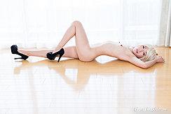 Lying On Her Back Nude Small Breasts Knee Raised In Black High Heels