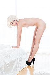 Hirasawa Eri Standing Beside Bed Bending Over Small Breasts In Black High Heels