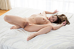 Lying On Bed Naked Long Hair Splayed Out On Covers Legs Spread Showing Her Shaved Pussy Bare Feet